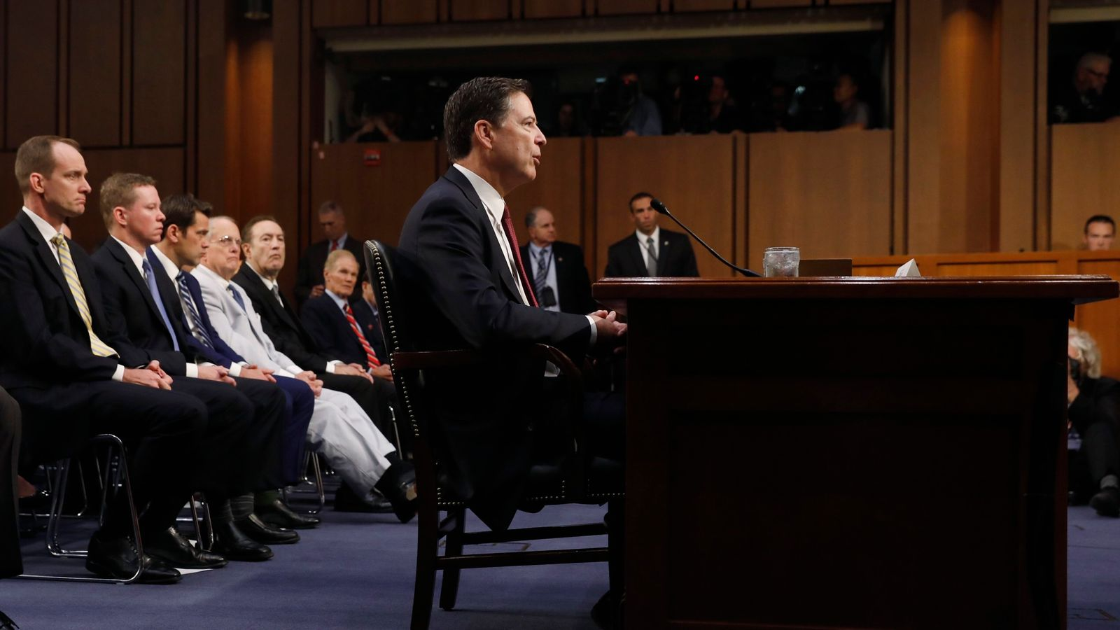 Former FBI Director James Comey testifies before a Senate Intelligence Committee