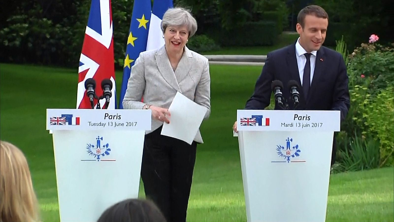 Theresa May's papers flutter away in the breeze during joint press conference with Emmanuel Macron