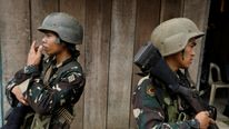 Philippines army soldiers take positions
