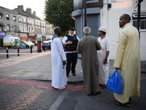 A police officer speaks to members of the local community in the wake of the Finsbury Park attack