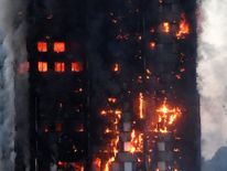 Flames and smoke engulf a tower block, in north Kensington, West London