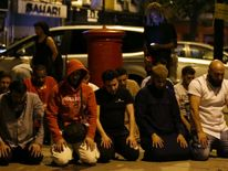 Worshippers pray at the scene of a terror attack in Finsbury Park