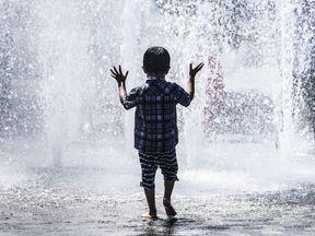 Children play in a water fountain in Bradford