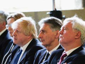 Sir Michael Fallon, Amber Rudd, Boris Johnson, Philip Hammond and David Davis listen to the PM during the election campaign