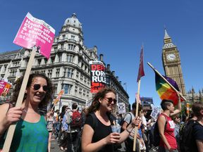 Protesters have gather outside in Westminster, central London to voice their anger at Theresa May's government and her alliance with the Democratic Unionist Party