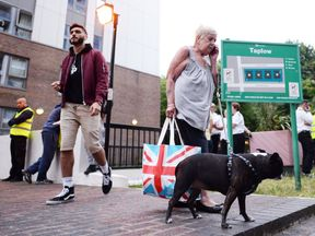 Resident Shirley Phillips leaves the Taplow tower block on the Chalcots Estate in Camden, London