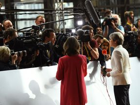 Theresa May speaks to the press after arriving at the EU summit