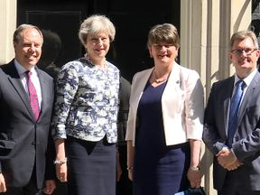 Theresa May greets Arlene Foster on the steps of Downing Street