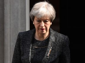 Prime Minister Theresa May leaves 10 Downing Street on June 15