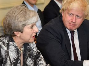Theresa May and Boris Johnson at her first Cabinet meeting since the election