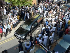 Mohammad Alhajali's coffin is taken from the East London Mosque for his burial