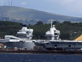 HMS Queen Elizabeth sits docked in the sunshine at Rosyth dockyard