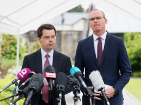 Northern Ireland Secretary James Brokenshire (left) speaks to the media at Stormont, Belfast, while Foreign Affairs minister Simon Coveney looks on