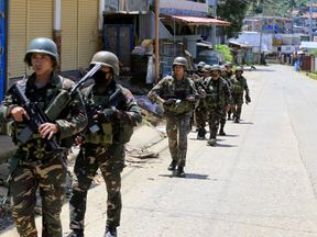Government soldiers conduct a foot patrol after a security inspection, as they continue their assault against insurgents from the Maute group, who have taken over large parts of Marawi City, Philippines June 17, 2017
