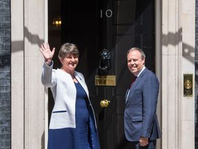 DUP leader Arlene Foster and deputy leader Nigel Dodds arrive at Downing Street