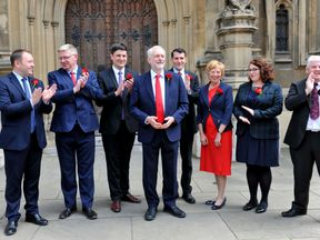 Jeremy Corbyn welcomes Scottish Labour MPs outside the Houses of Parliament