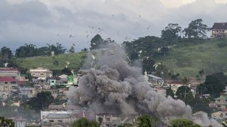 bomb explodes after being dropped on an Islamist militants' hideout in Marawi