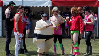 Revellers pose in fancy dress