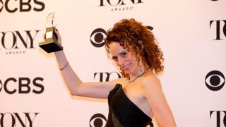 """Rebecca Taichman poses with her award for Best Direction of a Play for """"Indecent."""""""