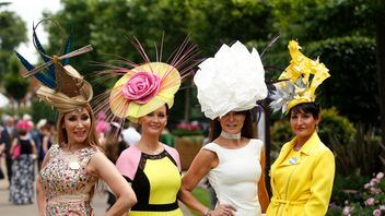 Racegoers pose before the races