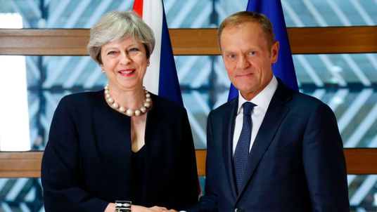 Theresa May and European Council President Donald Tusk pose during a summit in Brussels
