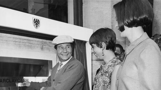 Actor Reg Varney makes the first withdrawal from a cash point