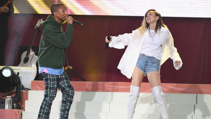 Singers Pharrell Williams and Miley Cyrus perform during the One Love Manchester benefit concert for the victims of the Manchester Arena terror attack at Emirates Old Trafford Manchester Britain