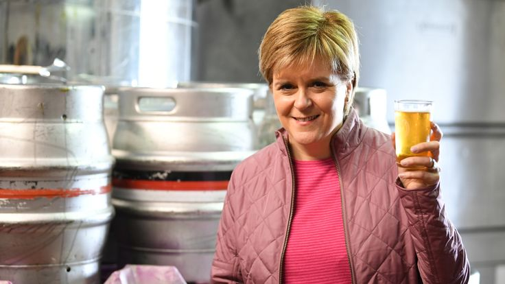 SNP leader Nicola Sturgeon has a ping of beer as she takes a tour of Kelburn Brewery while campaigning for the General Election on June 2, 2017 in Barrhead, East Renfrewshire