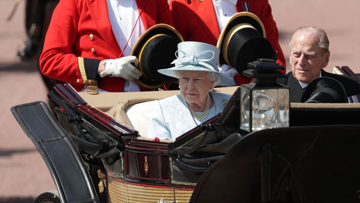 The Queen and the Duke of Edinburgh make their way down The Mall from Buckingham Palace