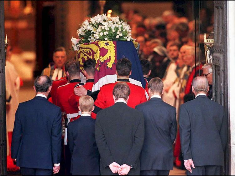 Prince Harry, second from the left, follows his mother's coffin into Westminster Abbey