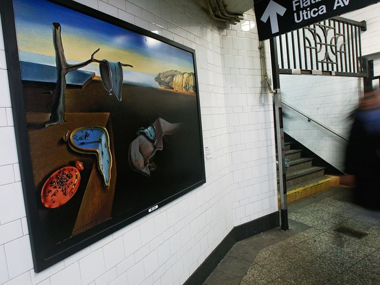 A reproduction of The Persistence of Memory on the New York subway
