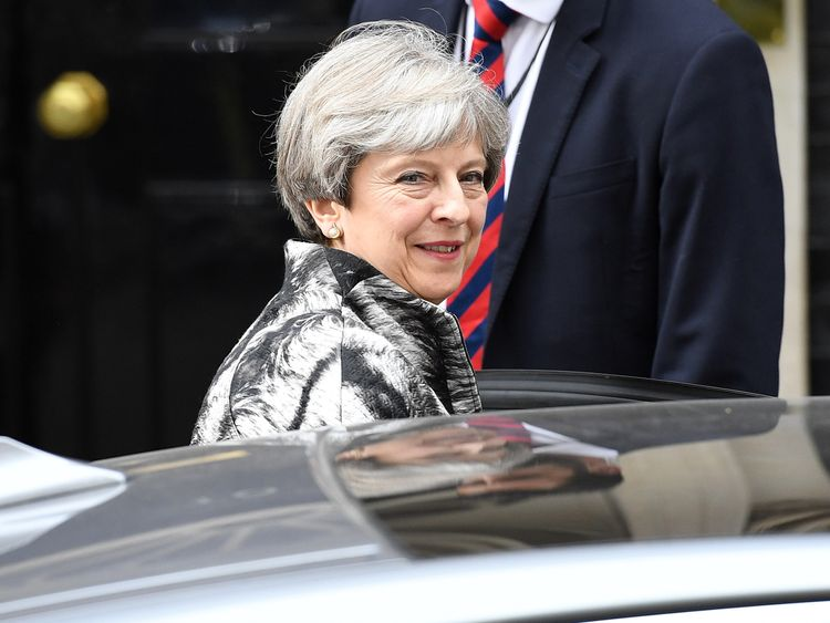 Theresa May leaves Number 10 for a meeting with the 1922 committee