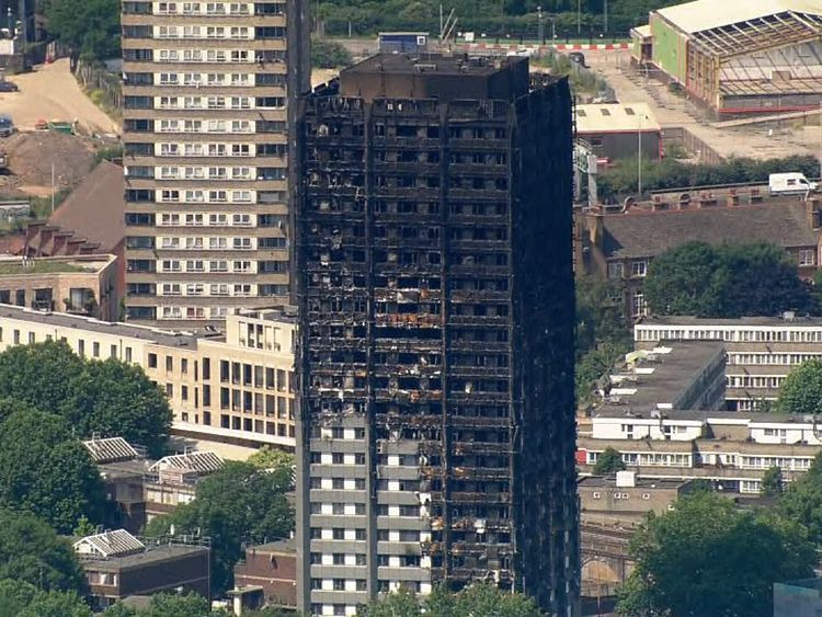 May calls for major investigation of cladding