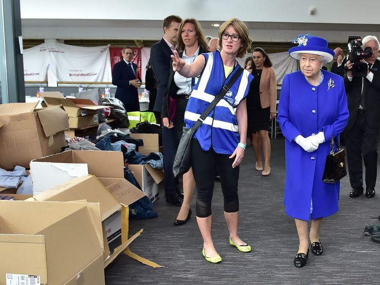Queen Elizabeth looks at donations to members of the community affected by the fire at Grenfell Tower