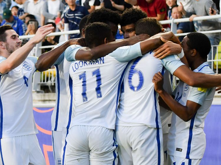 Dominic Calvert-Lewin is mobbed by his England teammates after scoring the opening goal