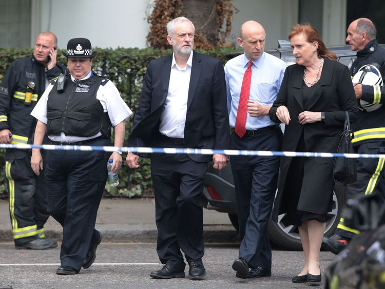 Labour leader Jeremy Corbyn visits the scene of the disaster with local MP Emma Dent Coad