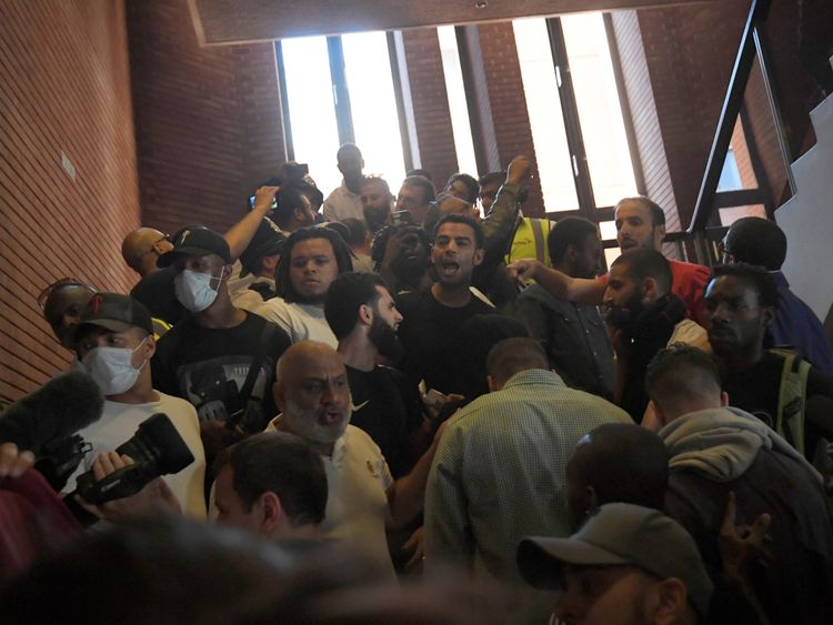 Dozens of protesters stormed into the town hall
