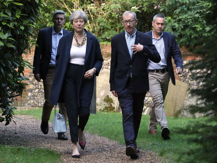 Theresa May and her husband Philip arrive at St Andrew's Church in Sonning, Berkshire