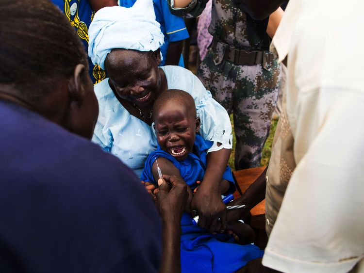 A child in Rejaf, South Sudan, is vaccinated in 2015 as part of an operation by the WTO and others to protect children from measles