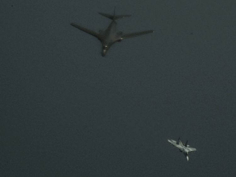 Russian SU-27 flanker peels away from US Air Force B-1B Lancer