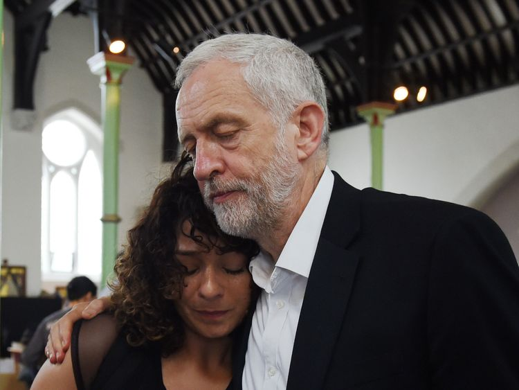 Jeremy Corbyn comforts a resident at St Clement's Church
