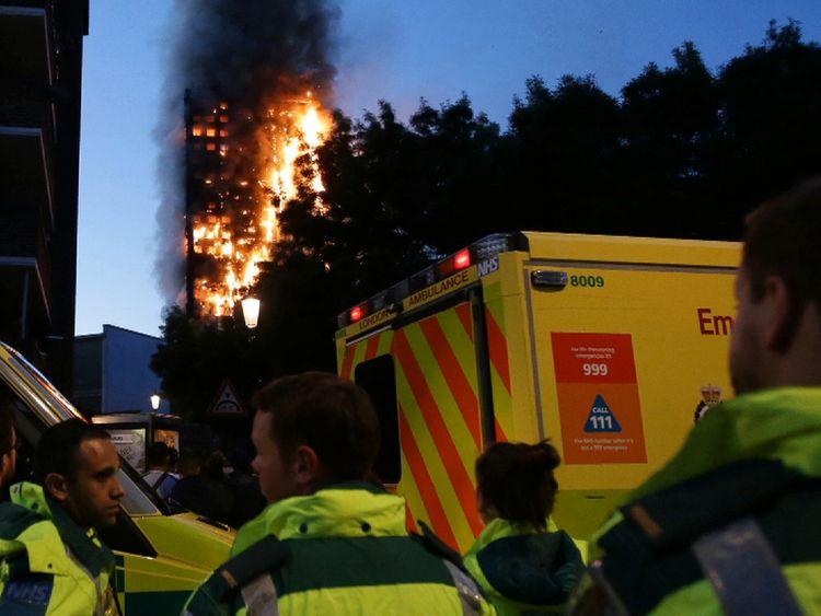 Ambulance service staff close to the fire