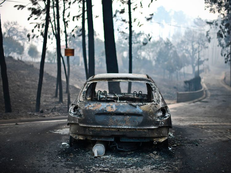 A burnt car on a road in Pedrogao, central Portugal