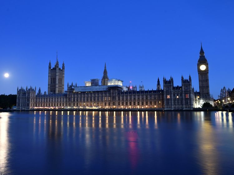 The sun rises over the Houses of Parliament