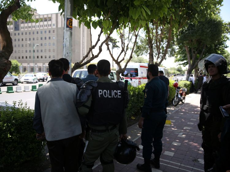 Iranian police near Tehran's parliament building during the attack