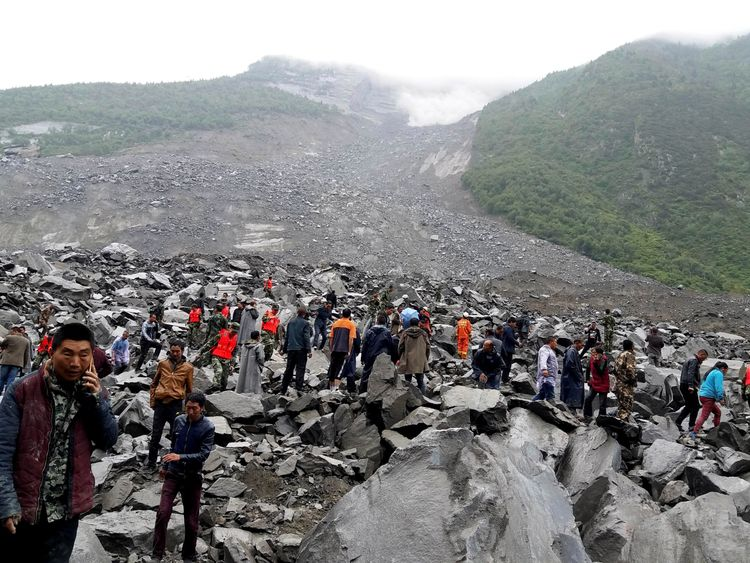 People search for survivors at the site of a landslide in Xinmo Village, Sichuan Province, China June 24, 2017.