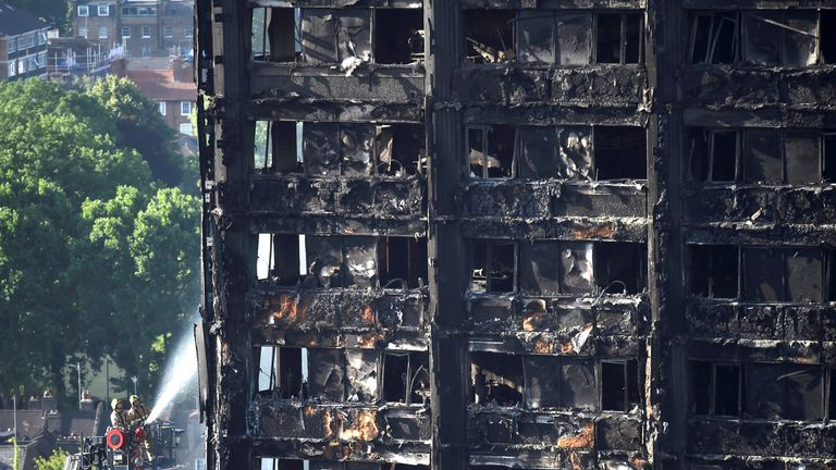 Firefighters spray water onto the Grenfell Tower block