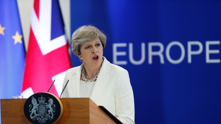Theresa May addresses the media at the end of the two-day EU summit