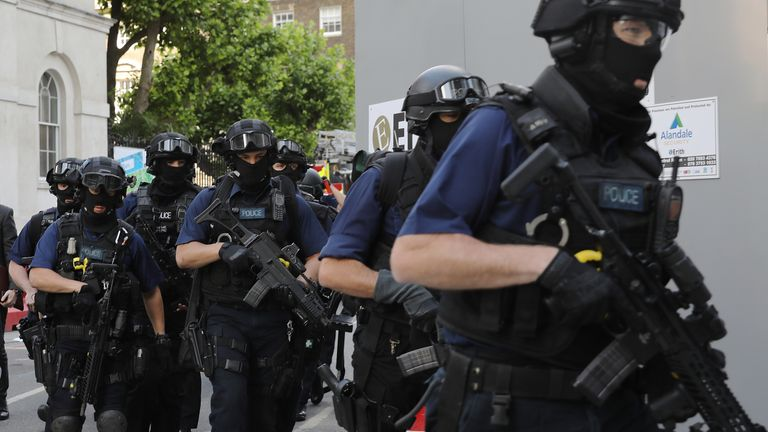 Counter terrorism officers march near the scene of last night's London Bridge terrorist attack