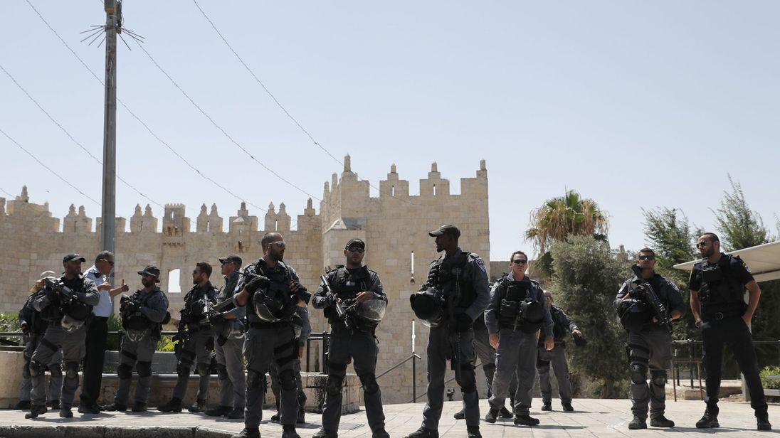 Israeli security forces stand guard following a shooting that left two officers dead